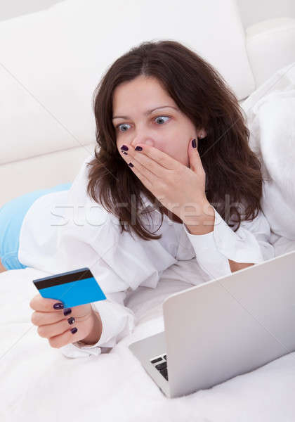 Excited woman making purchases online Stock photo © AndreyPopov