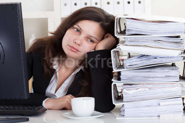 Stressed Woman Working In Office Stock photo © AndreyPopov