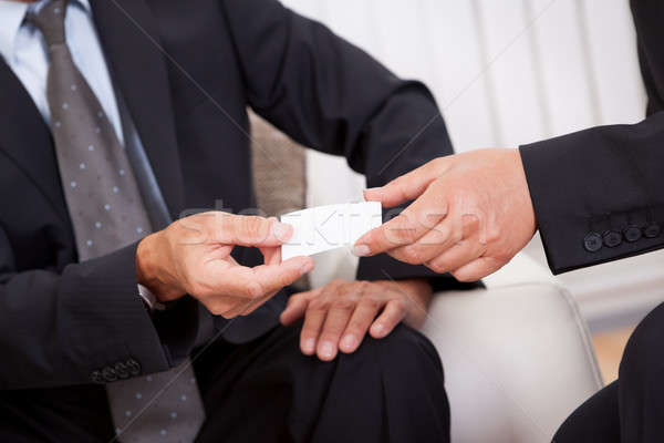 Business card being passed over Stock photo © AndreyPopov