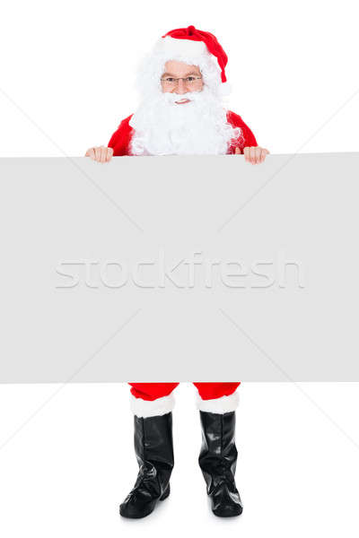Portrait of a santa holding blank placard Stock photo © AndreyPopov