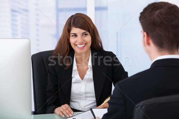Businesswoman Interviewing Male Candidate At Desk Stock photo © AndreyPopov
