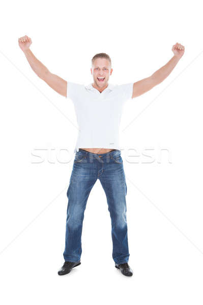 Handsome man punching the air with his fists Stock photo © AndreyPopov