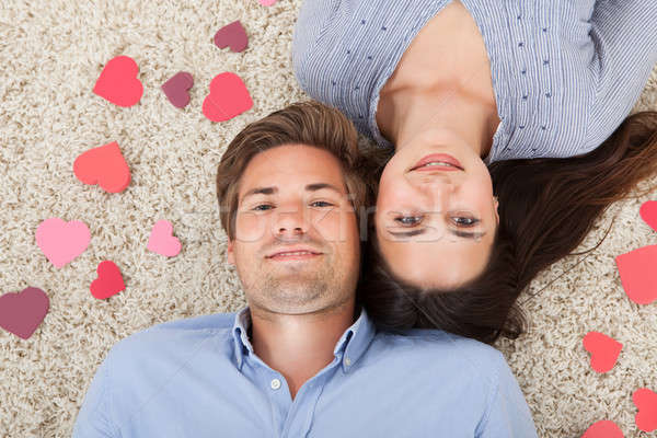 Loving Couple Lying On Rug At Home Stock photo © AndreyPopov