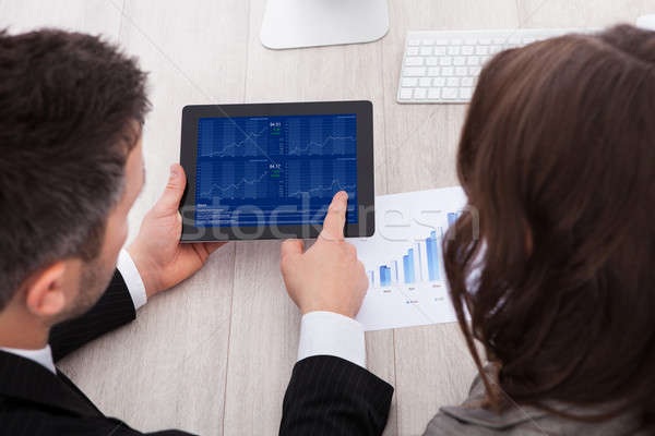 Businesspeople Analyzing Graph Stock photo © AndreyPopov