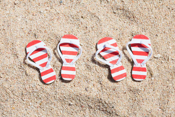 Two Pairs Of Striped Flip-flops Stock photo © AndreyPopov