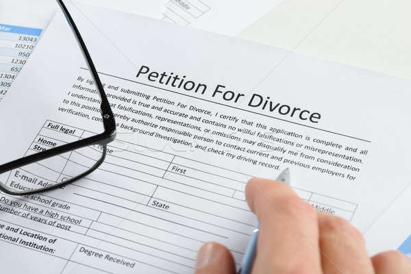 Hand With Pen On Petition For Divorce Paper Stock photo © AndreyPopov