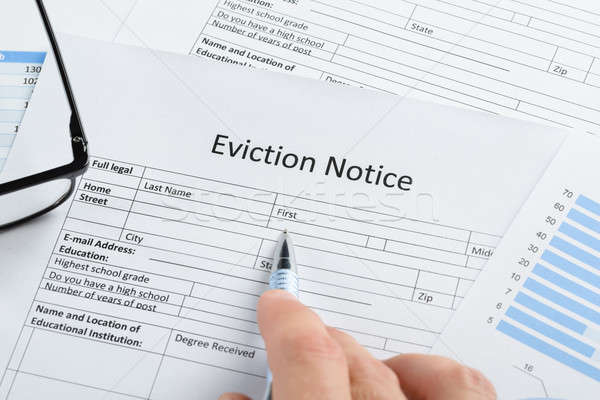 Hand With Pen And Eyeglasses Over Eviction Notice Stock photo © AndreyPopov