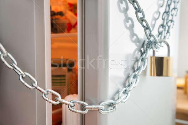Opened Door Of Locked Fridge Stock photo © AndreyPopov