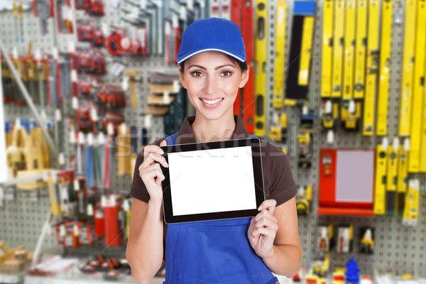Stock photo: Female Worker Holding Digital Tablet
