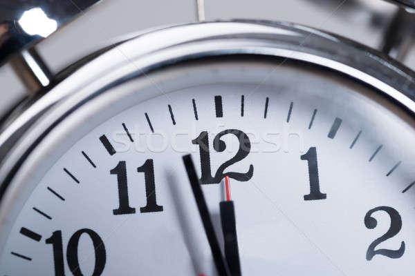 Foto meio-dia tempo relógio branco Foto stock © AndreyPopov