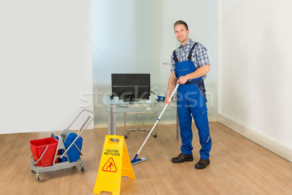 Man Cleaning Office Floor Stock photo © AndreyPopov