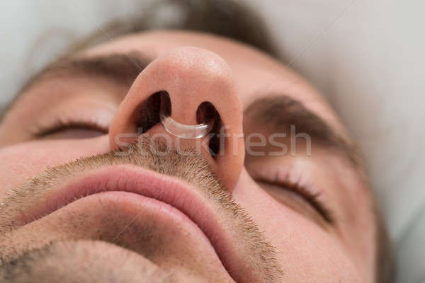 Man Face With Nose Clip Device Stock photo © AndreyPopov