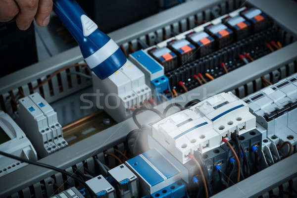 Technician Analyzing Fusebox With Torch Stock photo © AndreyPopov