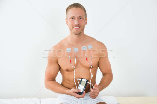 Young Man With Electrodes On Chest Stock photo © AndreyPopov