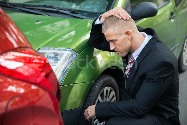 Upset Driver Looking At Car After Traffic Collision Stock photo © AndreyPopov