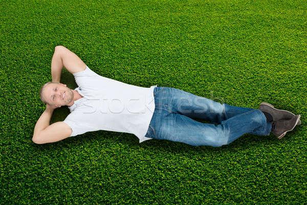 Man Lying On Grass Stock photo © AndreyPopov
