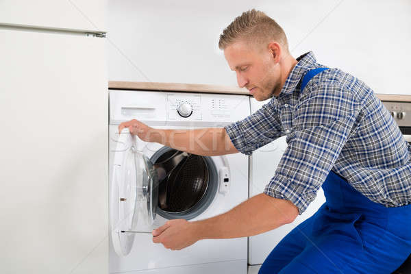 Technician Fixing Washing Machine Stock photo © AndreyPopov