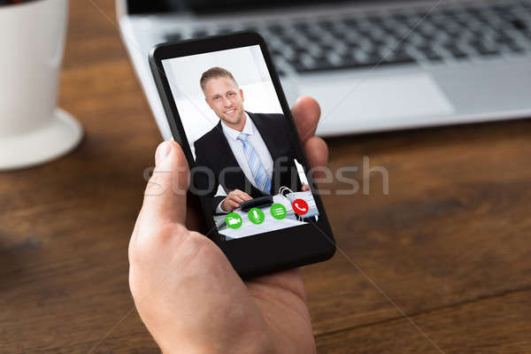 Person Videochatting With Colleague On Mobile Phone Stock photo © AndreyPopov