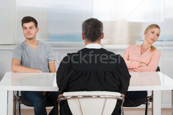Judge In Front Of A Unhappy Couple Stock photo © AndreyPopov