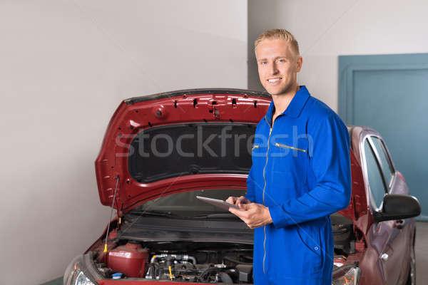 Mechanic Using Digital Tablet In Garage Stock photo © AndreyPopov