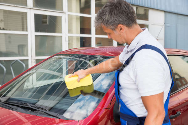 Worker Cleaning Car Windshield With Sponge Stock photo © AndreyPopov