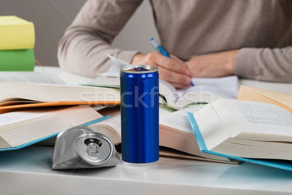 Student With Crashed Drink Can And Books At Table Stock photo © AndreyPopov