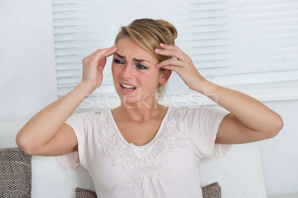 Portrait Of Woman Suffering From Headache Stock photo © AndreyPopov