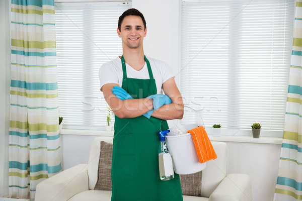 Happy Man With Cleaning Equipment Standing Arms Crossed Stock photo © AndreyPopov