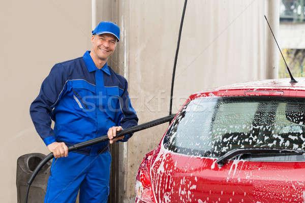 Masculina trabajador lavado rojo coche garaje Foto stock © AndreyPopov