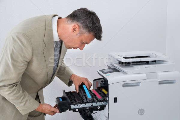 Mature Businessman Fixing Cartridge In Photocopy Machine Stock photo © AndreyPopov