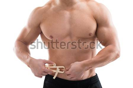 Strong Man Measuring Fats With Caliper Stock photo © AndreyPopov