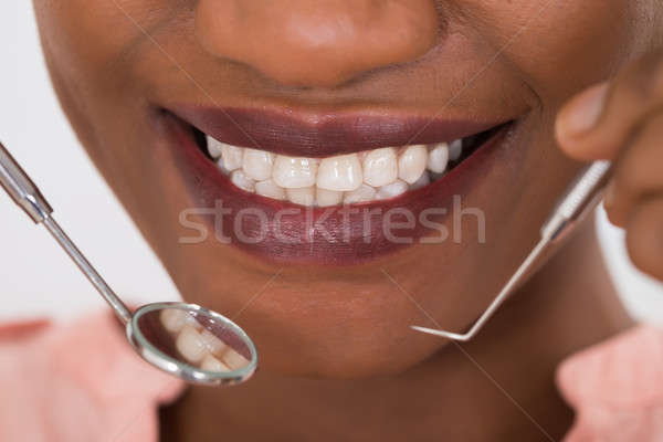 Woman Examining Her Teeth Stock photo © AndreyPopov