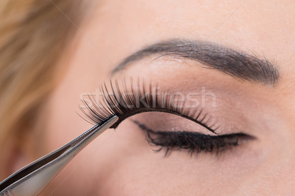 False Eyelashes Being Put On Woman's Eye Stock photo © AndreyPopov