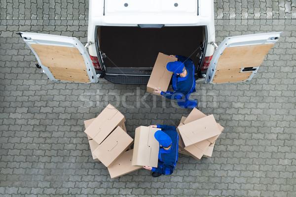 Házhozszállítás férfiak karton dobozok teherautó utca Stock fotó © AndreyPopov