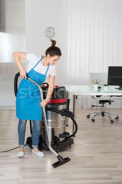Női gondnok takarítás padló porszívó iroda Stock fotó © AndreyPopov