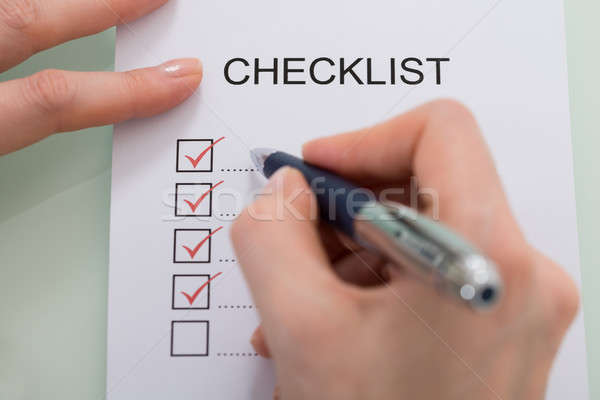 Woman Marking On Checklist Form With Red Pen Stock photo © AndreyPopov