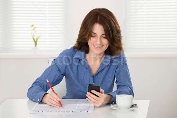 Woman Reading Classifieds On Newspaper Stock photo © AndreyPopov