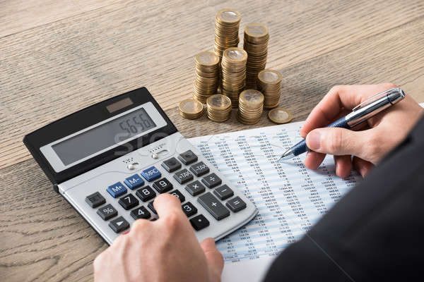 Close-up Of A Businessman Calculating Financial Report Stock photo © AndreyPopov