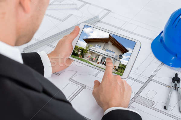 Architect Looking At Digital Tablet Stock photo © AndreyPopov
