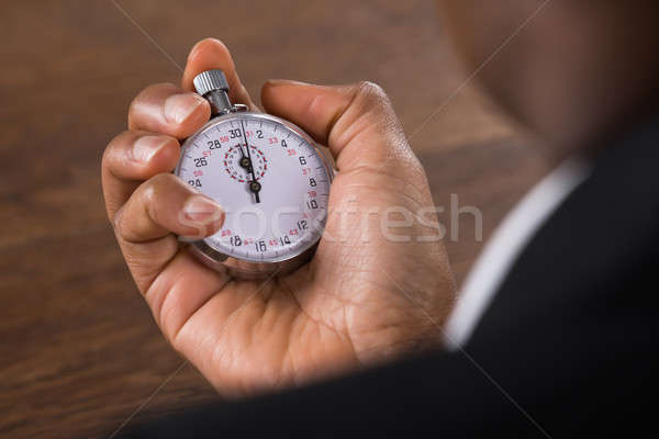Businessperson Holding Stop Watch Stock photo © AndreyPopov