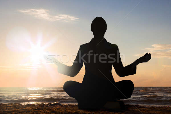 Person Practicing Yoga At Beach Stock photo © AndreyPopov