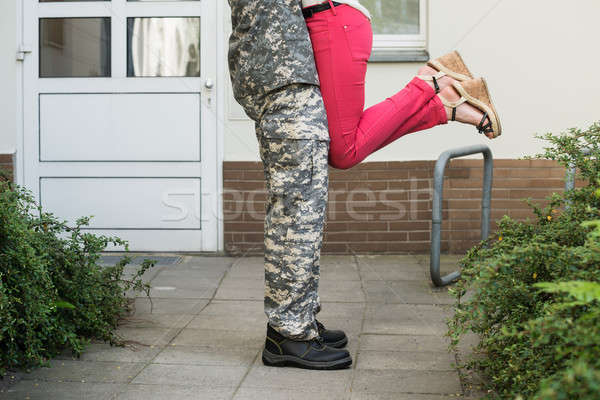 Wife Embracing Her Husband In Army Uniform Stock photo © AndreyPopov