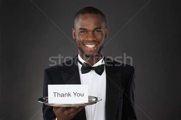 Pincér mutat köszönjük kártya fiatal boldog Stock fotó © AndreyPopov