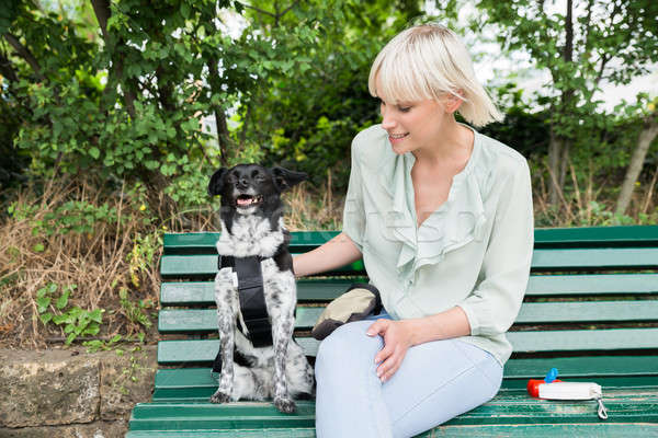 Stock photo: Young Woman With Her Dog