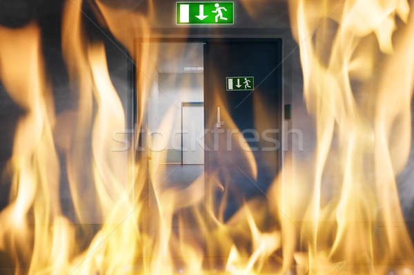 Fire Burning Near An Emergency Exit Door Stock photo © AndreyPopov