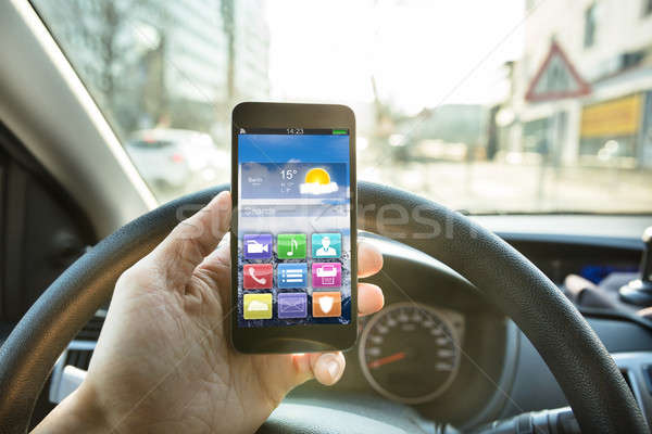 Person Using Mobile Phone While Driving Stock photo © AndreyPopov