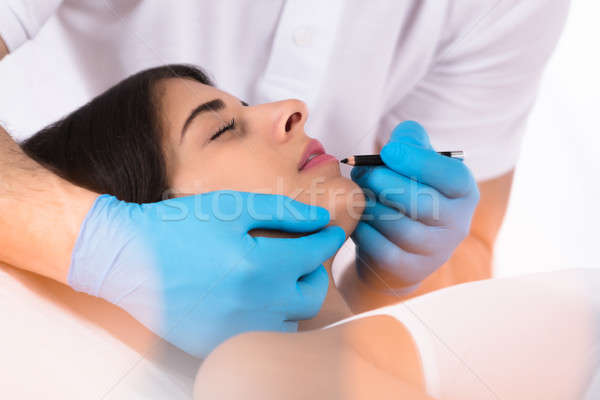 Cosmetologist Applying Permanent Make Up On Lips Stock photo © AndreyPopov
