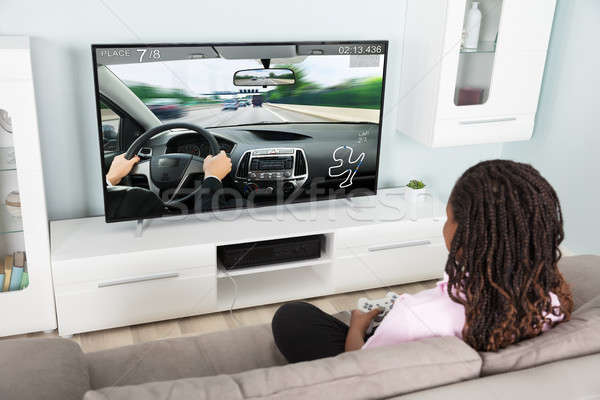 Girl Playing Video Racing Car Game Stock photo © AndreyPopov