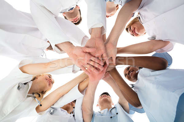 Smiling Medical Team Stacking Hands Stock photo © AndreyPopov