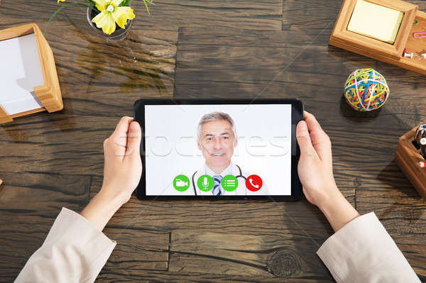 Businesswoman Doing Video Conference With A Doctor Stock photo © AndreyPopov